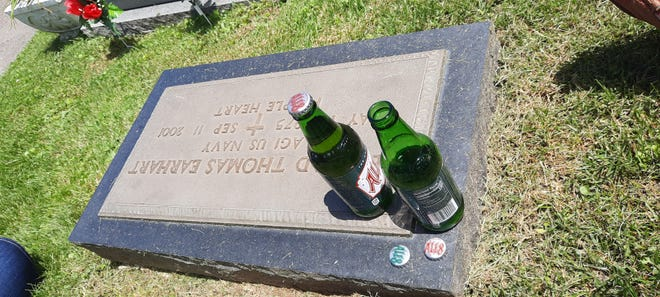 The family of Edward Earhart leave his favorite soda on his gravestone on 9/11