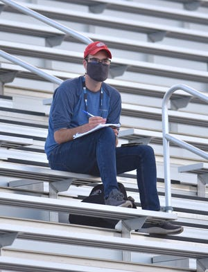 With pad and pen ready to take notes on the action Hometownlife.com sports reporter Colin Gay covers the Sept. 9, 2021 varsity soccer game featuring Novi at Canton High.