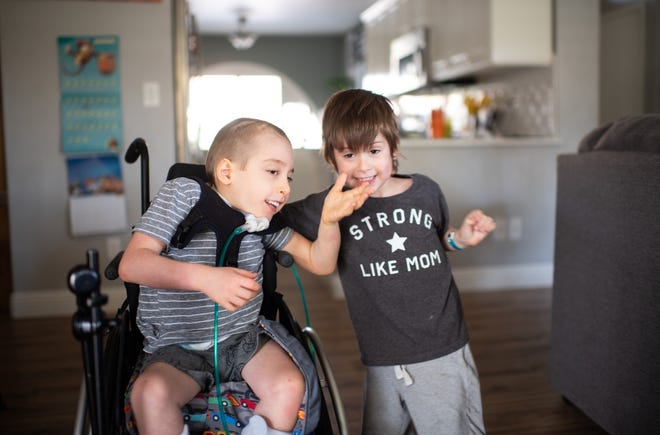 5-year old Miles (left) and 4-year-old Caleb Lefebvre require 24-hour home care for their spina bifida.