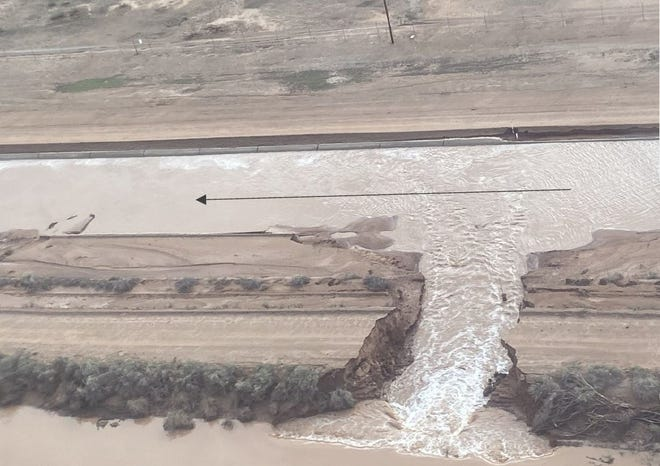 On July 25, 2021, flood water breached an earthen dike and flowed into the Central Arizona Project canal near Picacho Park.