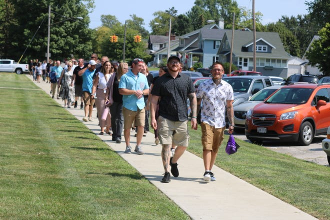 Those in the local recovery community, as well as many others affected by the opioid epidemic, partake in a remembrance walk to pay respect to those lost to overdose in the past year and reflect on their own journey.