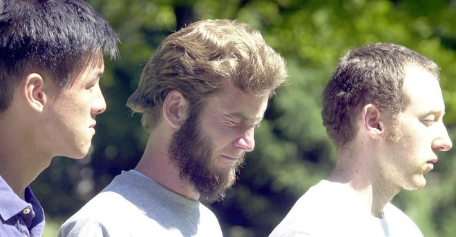 Justin Fong (from left) David Keyes, and Keddy Williamson take in a  peace vigil in the heart of the Earlham College campus the afternoon of Sept. 11, 2001.