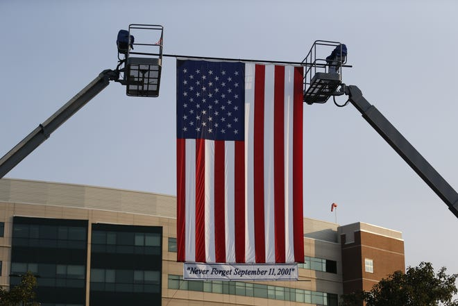 A giant flag flies outside Reid Health in remembrance of the Sept. 11, 2001, terrorist attacks.