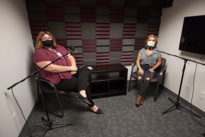 Reporter K. Sophie Will, left, prepares for an interview with The Spectrum's Elle Cabrera.