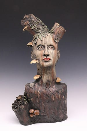 """""""I got interested in the forms of a lot of the fallen stumps and logs,"""" said Lesley Nolan, who's """"Branching Out"""" is part of LeMoyne Arts exhibit."""