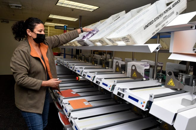 Christi Hill operates a mail-in ballot sorting machine at the Ventura County Elections Division office on Sept.