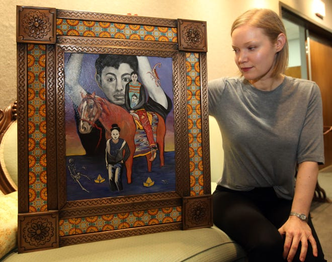 Dawn Sabala, interim director at the Tulare Historic Museum, shows artwork scheduled for display to commemorate Hispanic Heritage Month.