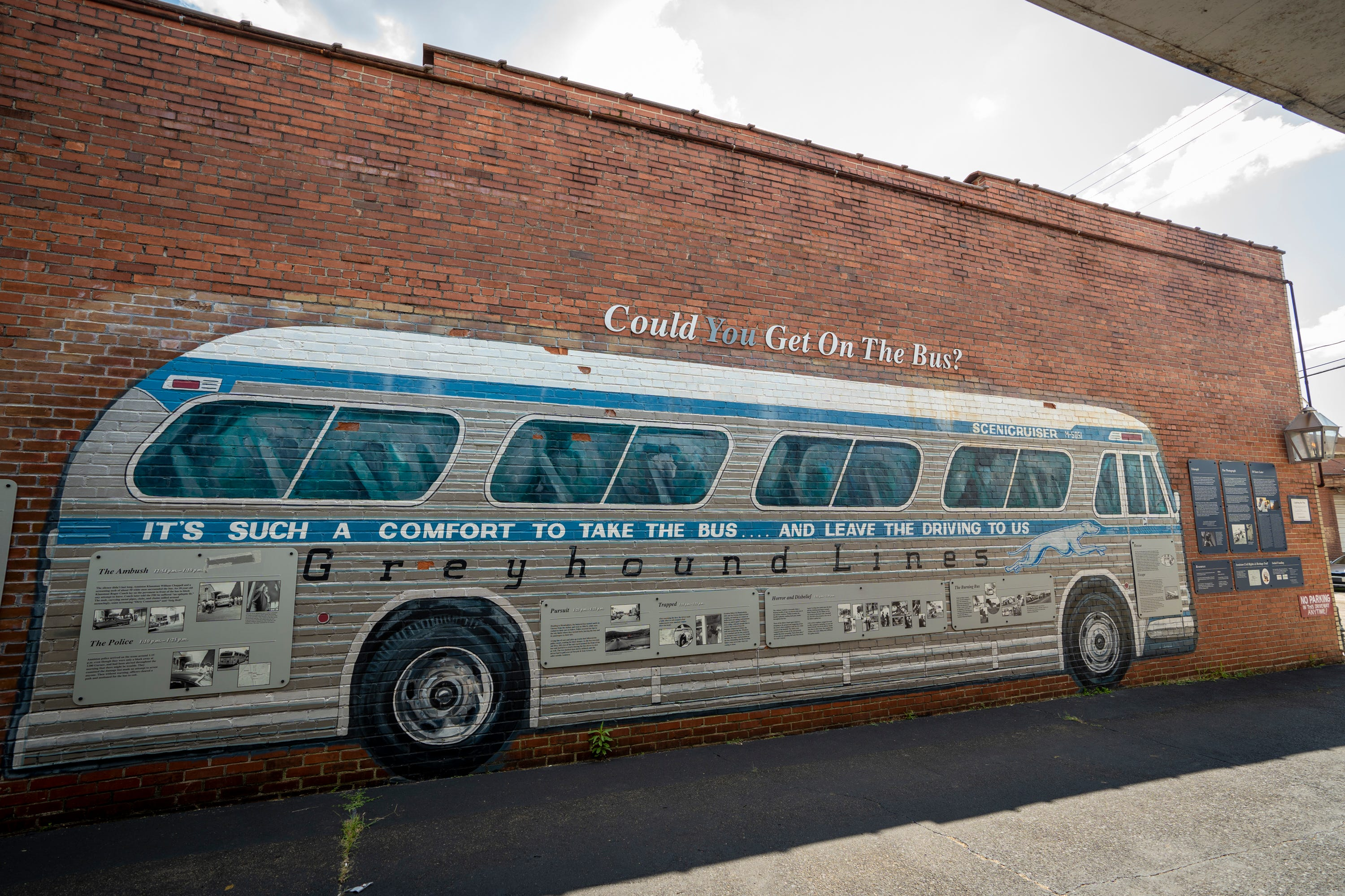 A mural and plaques adorn the alley beside the Greyhound station where Freedom Riders were met by an angry mob in 1961, now preserved as the Freedom Riders National Monument, in Anniston, Ala., on August 13, 2021. Eleven days into the Freedom Rides aimed at ending segregation, Hank Thomas and other Freedom Riders huddled on a bus on May 14, 1961, just outside Anniston, Alabama, as a white mob slashed tires on their bus, pounded it with tire irons and then threw a firebomb inside. As flames spread, the civil rights activists scrambled off the bus into the angry crowd that beat them with bats, fists and those same tire irons. That brutal confrontation could have ended the group's 14-day mission to desegregate public interstate accommodations. Instead, more Freedom Riders boarded buses headed into hostile territory. The rides focused attention on the violent resistance to segregation and are credited with helping integrate accommodations.
