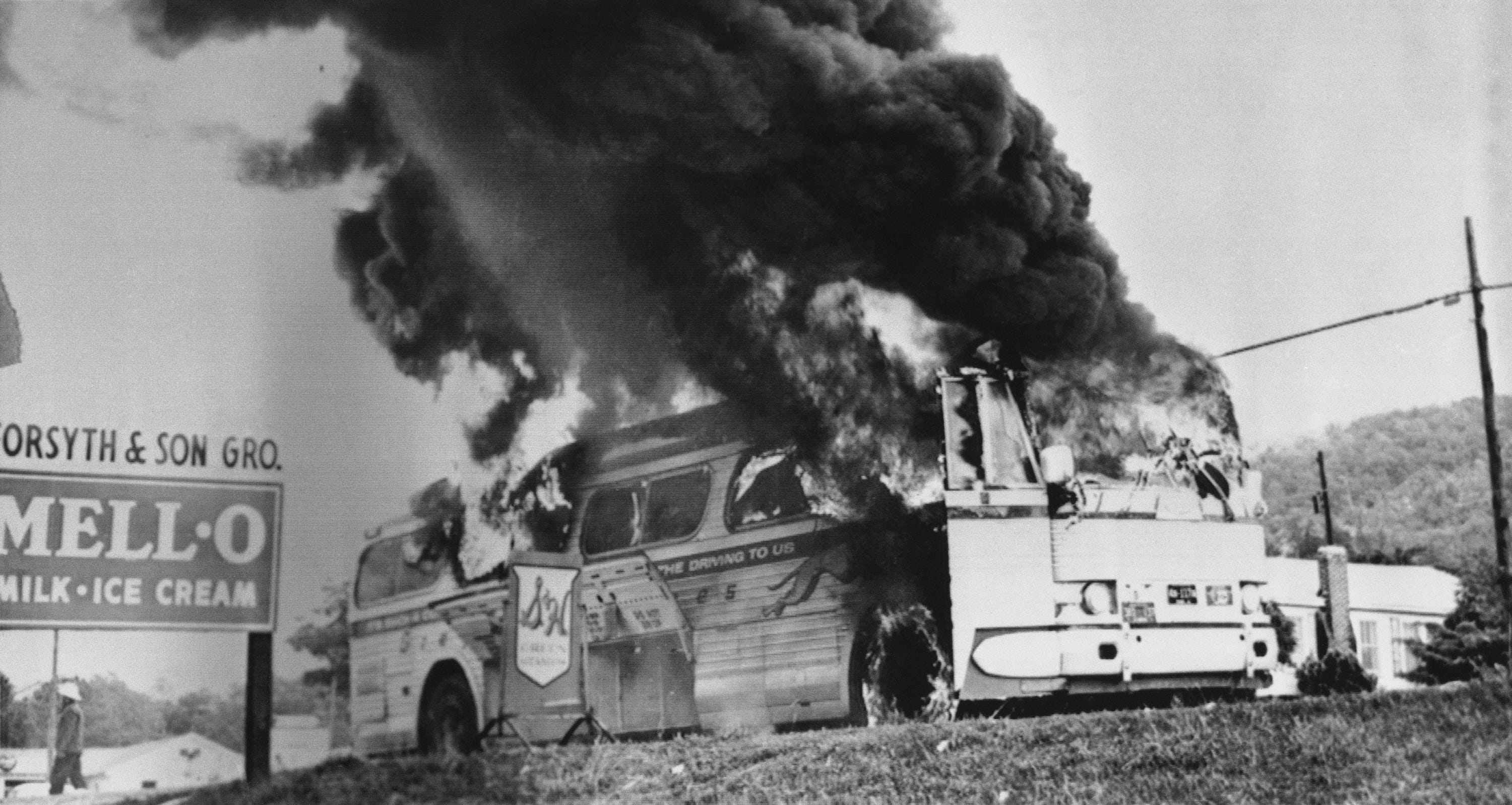 A Freedom Rider bus went up in flames when a firebomb was tossed through a broken window near Anniston, Ala., May 14, 1961. The bus, which was testing bus station segregation in the South, had stopped due to flat tires inflicted by a white mob at the Anniston bus station. Passengers escaped without serious injury, but endured beatings by a white mob that followed the bus as it left Anniston.