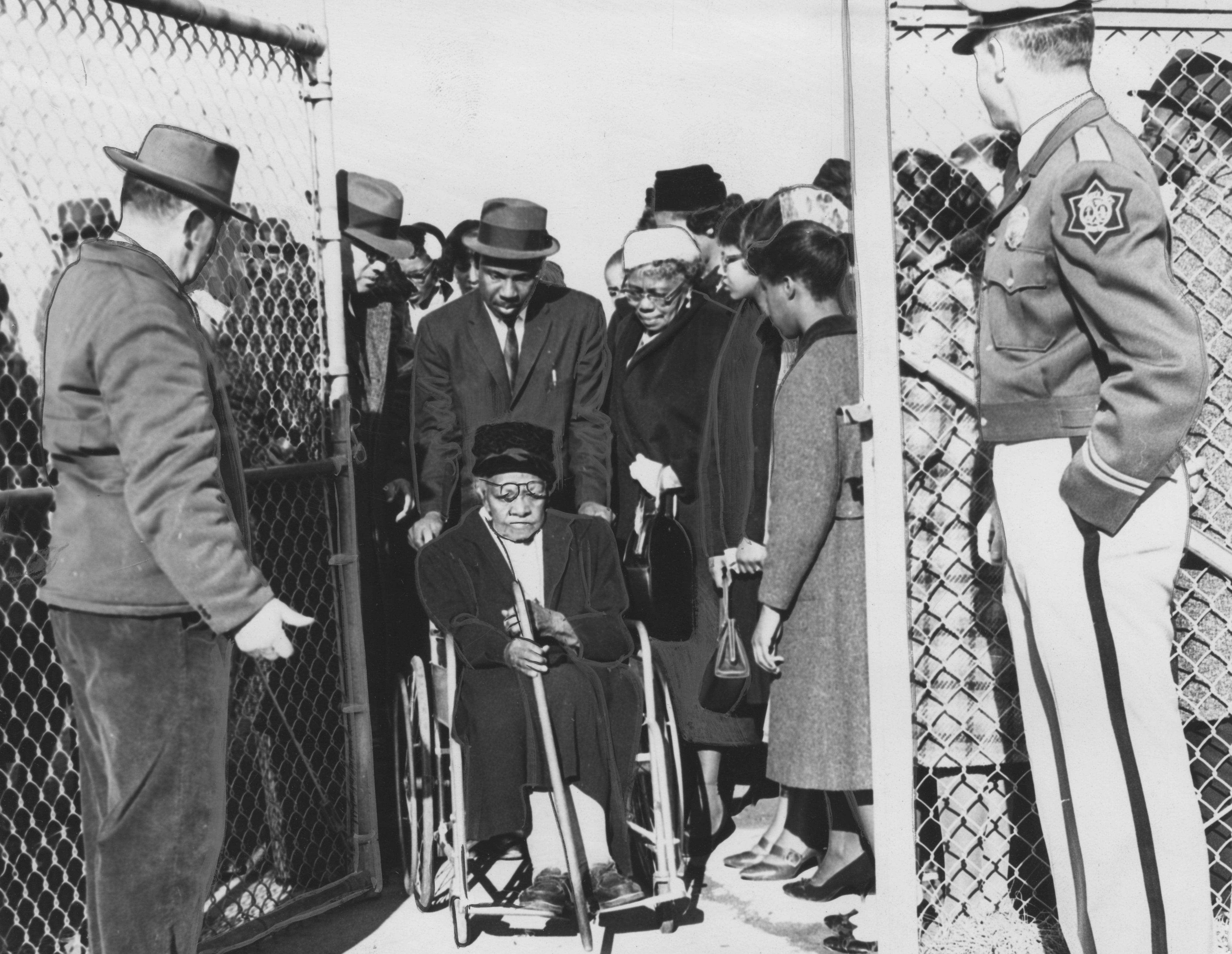 Mrs Mary Gill, proud 95-year-old great-grandmother of John A Gaines of the Friendship Nine imprisoned in the Rock Hill sit-ins, enters the prison gate in a wheelchair to visit the youth, South Carolina, February 5, 1961.