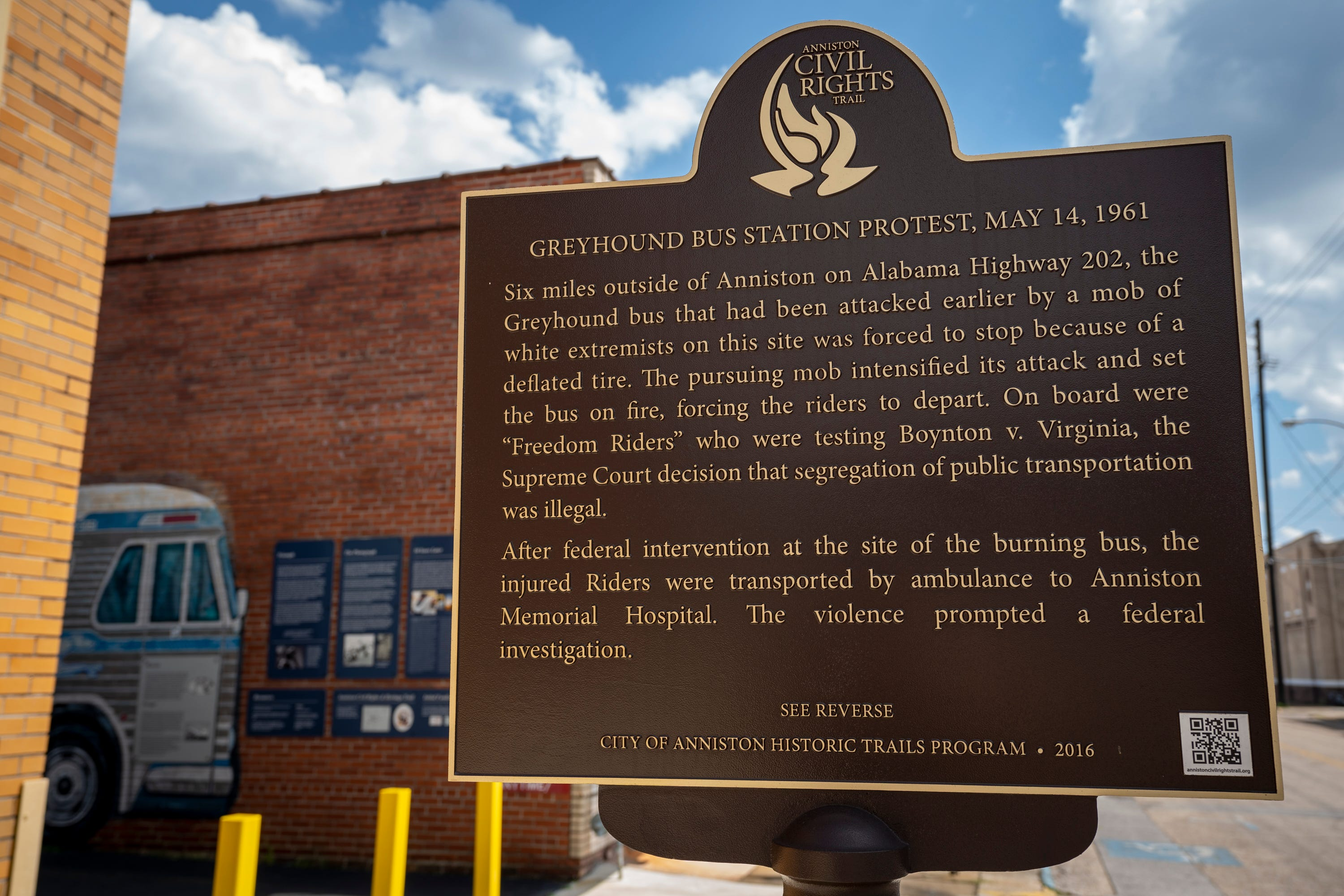 A historical marker describes what took place in the alley beside the Greyhound station where Freedom Riders were met by an angry mob in 1961, now preserved as the Freedom Riders National Monument, in Anniston, Ala., on August 13, 2021. Eleven days into the Freedom Rides aimed at ending segregation, Hank Thomas and other Freedom Riders huddled on a bus on May 14, 1961, just outside Anniston, Alabama, as a white mob slashed tires on their bus, pounded it with tire irons and then threw a firebomb inside. As flames spread, the civil rights activists scrambled off the bus into the angry crowd that beat them with bats, fists and those same tire irons. That brutal confrontation could have ended the group's 14-day mission to desegregate public interstate accommodations. Instead, more Freedom Riders boarded buses headed into hostile territory. The rides focused attention on the violent resistance to segregation and are credited with helping integrate accommodations.