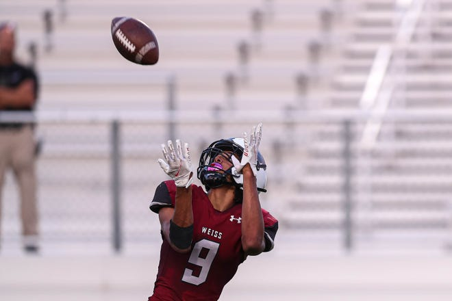 Weiss wide reciever Micah Gifford, catching a pass against Rouse, accounted for five touchdowns to earn Player of the Week honors from the American-Statesman.
