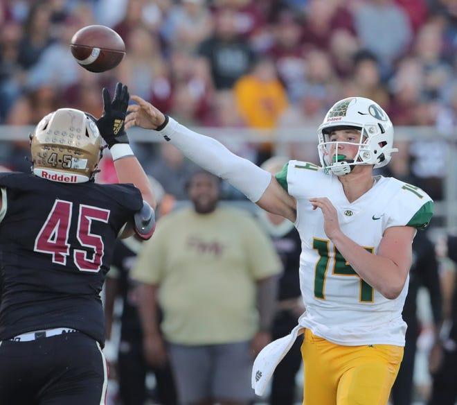 Stow's Kaden Spiegel pressures Medina quarterback Drew Allar during a second quarter pass attempt on Friday, Sept. 10, 2021 in Stow, Ohio.  [Phil Masturzo/ Beacon Journal]