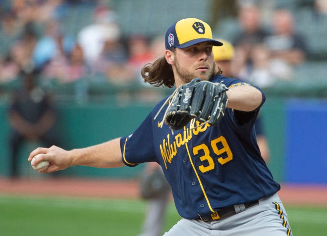 Milwaukee starting pitcher Corbin Burnes delivers a pitch at Cleveland, Sept. 11, 2021. (AP Photo/Phil Long)
