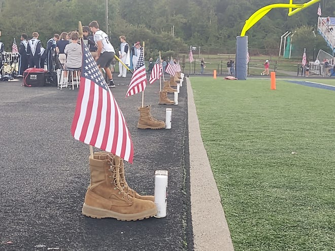 A memorial was created for military personnel who died in Afghanistan before the Twinsburg varsity football team's game against Hudson on Friday evening.