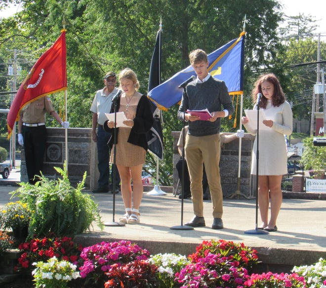 From left, Morgan Keller, Sam Gielink, and Ava Pesicka, all students at Twinsburg High School, each took turn reading the timeline of events that happened September 11.