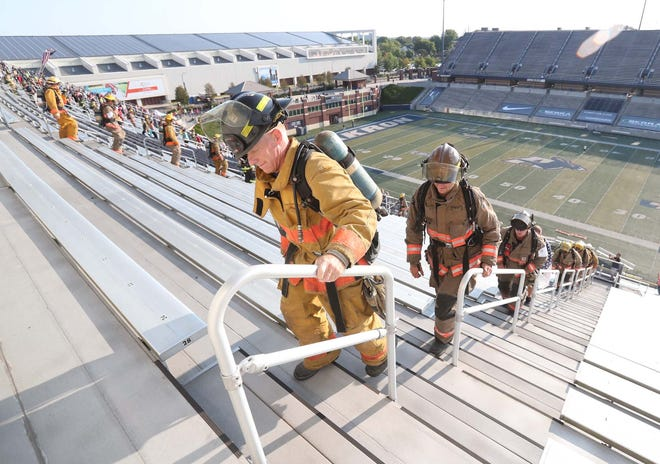 Lt. Cliff Musgrave of the Akron Fire Department leads the group of first responders and civilians on the 9/11 Memorial Stair Climb at InfoCision Stadium in Akron on Saturday.