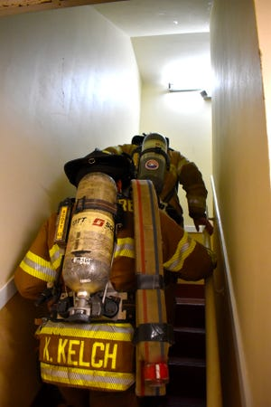 Ardmore firefighters make their way up the FIrst Bank & Trust stairwell for a 9/11 memorial climb Saturday, Sept. 11, 2021. The event was organized by Heroes with Hope of Southern Oklahoma.