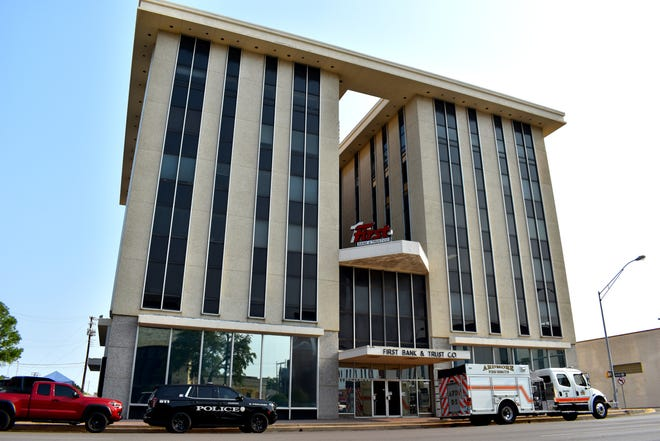 Ardmore police and fire vehicles parked outside of the six-story First Bank & Trust building Saturday, Sept. 11, 2021. The building hosted the first 9/11 memorial stair climb this year.