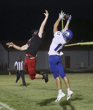 Boonville junior Jackson Johns goes high for the ball for a touchdown in the second quarter Friday night against Southern Boone in the Tri-County Conference opener in Ashland. The Pirates put on a clinic offensively with over 400 yards in total offense for a 40-14 victory.