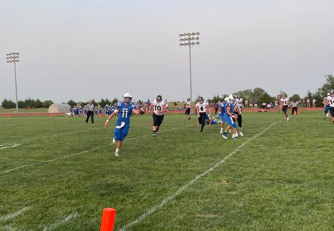 Sedan's senior quarterback, Brec Long, races towards the end zone in Friday's game against Flinthills.