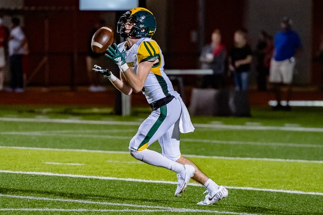 Rock Bridge's Payton Messer (5) fields the second-half kickoff, which he returned 91 yards for a touchdown against Jefferson City on Friday night.