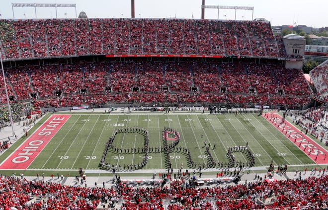 """Members of the Ohio State Marching Band form """"Script Ohio"""" before Saturday's NCAA Division I football game between the Ohio State Buckeyes and the Oregon Ducks on September 11, 2021, at Ohio Stadium in Columbus, Oh."""