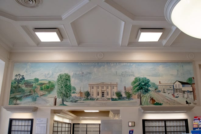 A mural depicting scenes of downtown Cambridge greets visitors as they enter the Wheeling Avenue post office.
