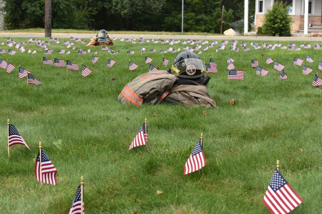 A total of 343 miniature American flags grace the front lawn of the Adrian City Fire Department, Saturday morning. Along with some fire department gear, the flags were placed to represent the Twin Towers that collapsed 20 years ago during the Sept. 11, 2001, terrorist attacks.