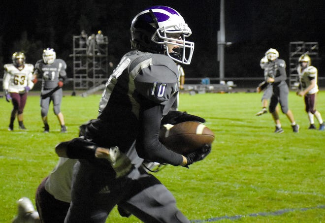 Little Falls Mountie Brayton Langdon crosses the goal line with the go-ahead touchdown during the fourth quarter of Friday's game against Canastota.