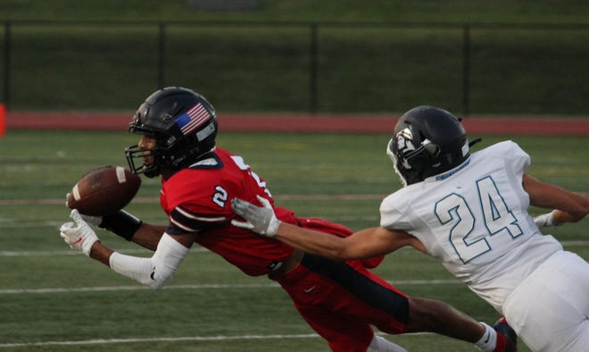 Truman wide receiver Patrick Martin makes a diving catch in the first quarter of Friday night's football game against Oak Park.
