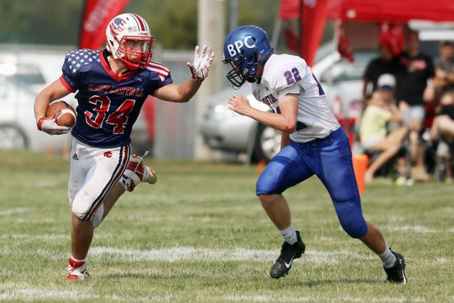 West Central High School's Devin Shaw (34) fends off Dalton Huffman (22) during their game against Bushnell-Prairie City Saturday Sept. 11, 2021 at Biggsville.