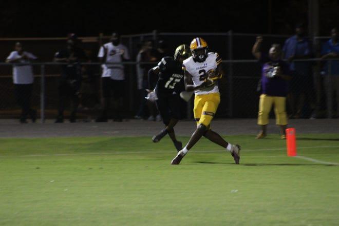 Three-star receiver, MArcus Peterson, reels in a fourth quarter touchdown catch against Oakleaf.