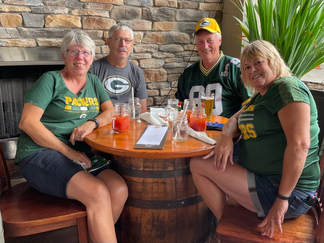 Packers fans began to gather at Culhane's Irish Pub at Tinseltown on Saturday. From the left are Mary Wampole, Richard Wampole, Bob Zwiefelhofer and Kim Zwiefelhofer of Chippewa Falls, Wis.