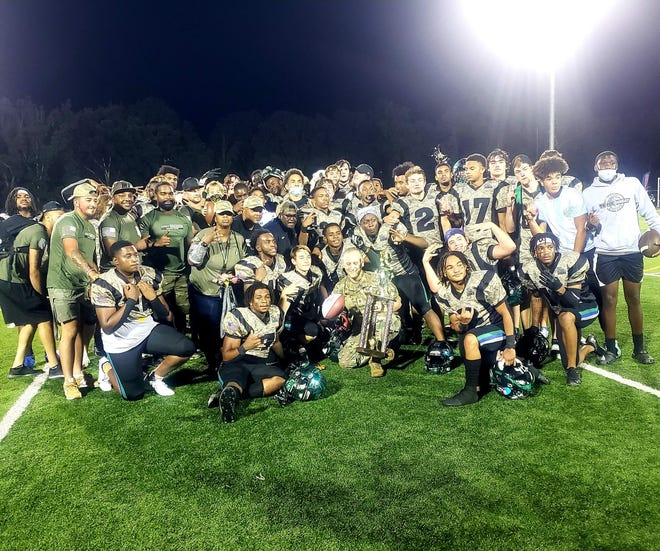 The Mountain Island Charter football team celebrates after its win over Union Academy in Week 4 of the fall 2021 season.