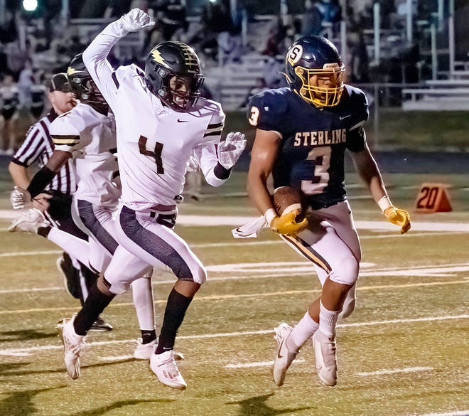 With Galesburg's Mikey Eiker in pursuit, Sterling's Antonio Tablante (3) crosses the goal line for a 53-yard touchdown run to tie the score 21-21 against the Silver Streaks on Friday night at Roscoe Eades Stadium in Sterling
