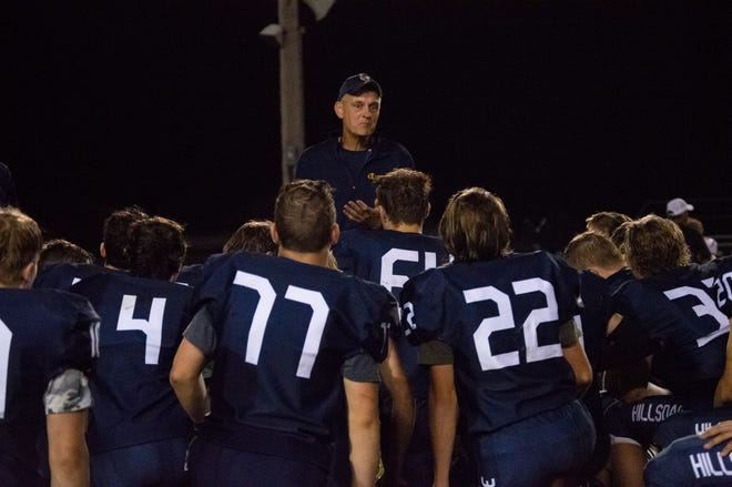 Hillsdale head coach Marc Lemerand talks to the team after their 42-14 win over Onsted.