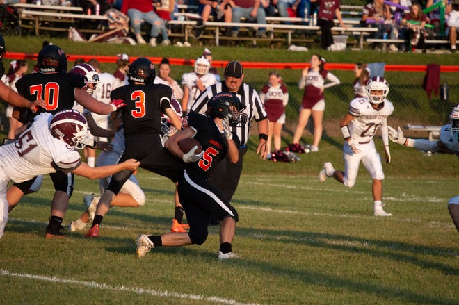 Jonesville running back Dominic Aponte (5) slips through a Union City Charger tackle in a week three game