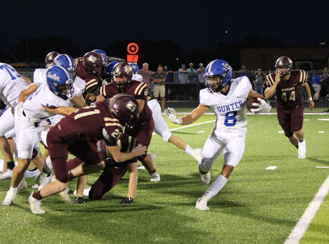 Gunter's Ethan Sloan looks to avoid Whitesboro's Kayden Unclebach during the Tigers' non-district victory over the Bearcats.