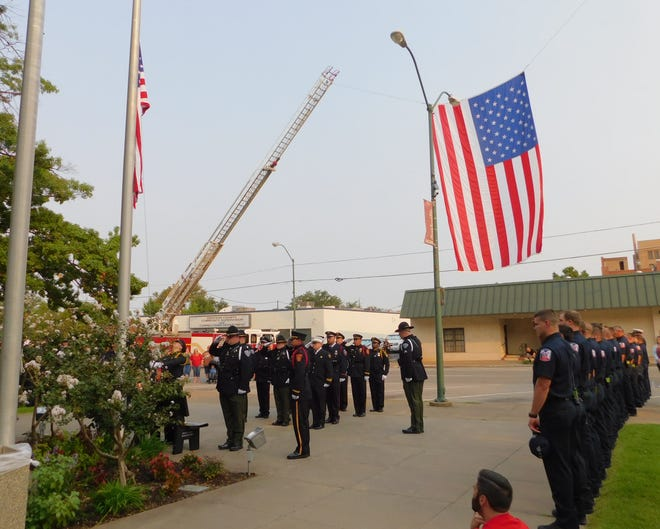 Members of the color guard lower the American Flag to half staff at Grayson County Courthouse during a memorial for the 20th anniversary of the 9/11 attacks.