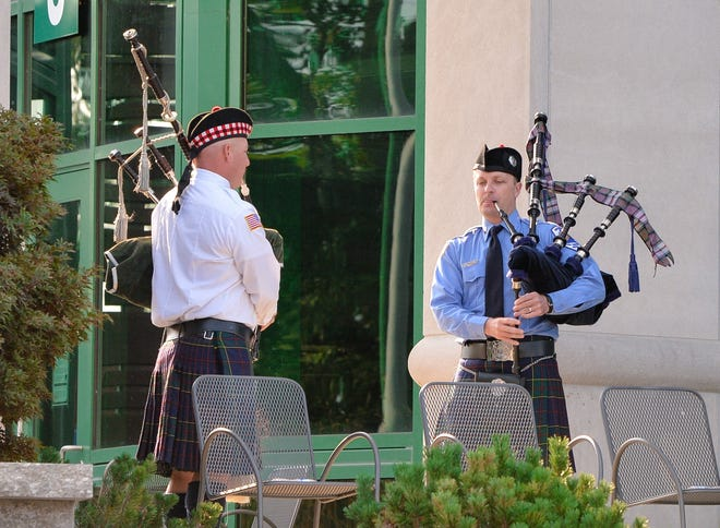 """Members of the Honor Guard play """"Amazing Grace"""" to close out the 9/11 ceremony Saturday at Ivy Tech west of Bloomington."""