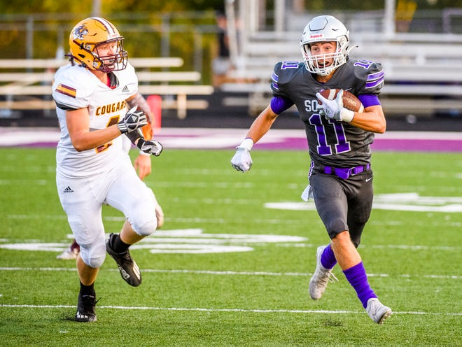 South's Cooper Fox (11) runs during the Bloomington South versus Bloomington North football game at Bloomington High School South on Friday, September 10, 2021.