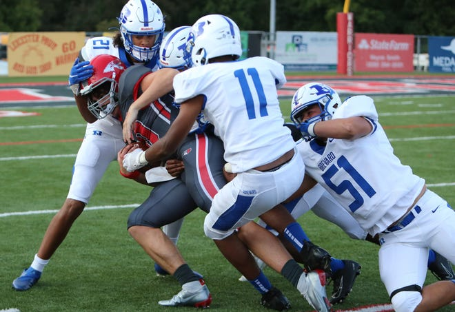 Erwin quarterback Iggy Welch is brought down by a host of Brevard tacklers, including Riley Anderson (51), Nahshon Griffin (11) and Hadden Johnson (21).
