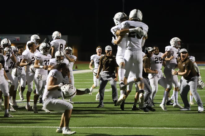 The Garden City Buffaloes celebrate after beating the Hutchinson Salthawks 13-7 in overtime Friday, Sept. 10, 2021 at Gowans Stadium in Hutchinson.
