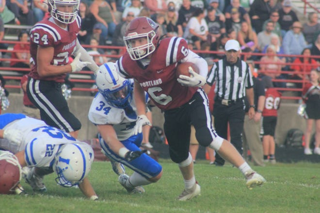 Portland's Drew Miller tries to break free during a contest against Ionia.