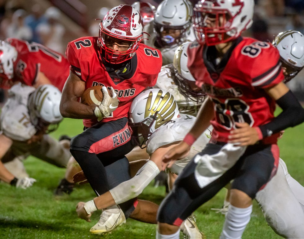 Pekin running back Kanye Tyler tears through the Dunlap defense in the second half Friday, Sept. 10, 2021 in Pekin. The Dragons defeated the Eagles 27-7.