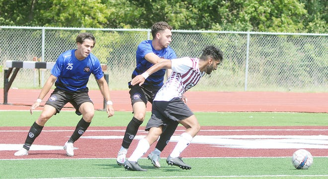 Bethel junior Mussawir Ahmed gets held up during play Saturday against Central Christian. The Threshers stopped the Tigers 2-1 for their second straight win against a Sooner Athletic Conference opponent. Bethel hosts Ecclesia College Tuesday.