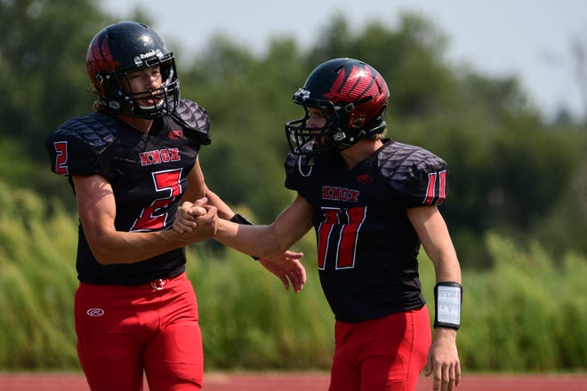 Knox County's Carter Marble (left) celebrates with Branson Miller after the first of Miller's three touchdowns Saturday against Northland Christian.