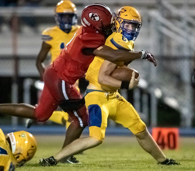 Auburndale quarterback Zach Tanner is chased by Kathleen's Kyandre Anderson-Cobbett during first-half action at Johnny Johnson Stadium.