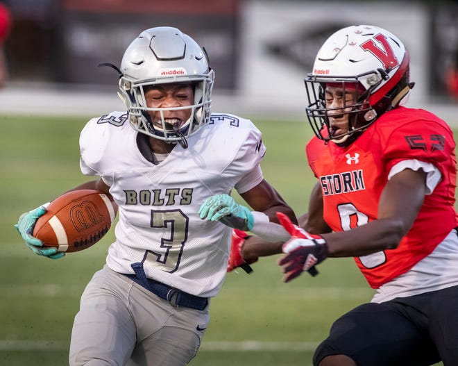 Ridge Community wide receiver Rick Penick is chased by Victory Christian lienbacker Purvis Adamson after a big gain during the first half at Southeastern's Victory Field last week. On Friday, Ridge will play host to Winter Haven, and Victory Christian travels to Bartow.